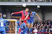 Vadaine Oliver of York City FC and Darius Charles of AFC Wimbledon jump during the Sky Bet League 2 match between AFC Wimbledon and York City at the Cherry Red Records Stadium, Kingston, England on 19 March 2016. Photo by Stuart Butcher.