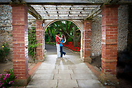 Engaged couple embracing in Connaught Gardens, a walled Victorian garden in Sidmouth, Devon.
