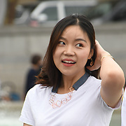 A chineses girl taking a selfies in Trafalgar square on 18 August 2018, London, UK.