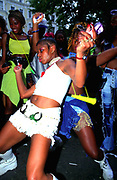 Ragga girls dancing at Notting Hill carnival London, UK 2000's