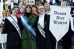"© Licensed to London News Pictures. 08/03/2015. London, UK. Helen Pankhurst, Gemma Arterton and Laura Pankhurst at the ""Walk In Her Shoes"" event to mark International Women's Day at The Scoop amphitheatre on the south bank in London. Photo credit : Vickie Flores/LNP"