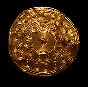 Gold Disk from a Reel.  Bronze Age, found in Enniscorthy, Ireland.  Made about 800 B.C.  Ireland experienced a period of resurgence in the production of gold work during the late Bronze Age.  Numerous objects noteworthy for their gold content, innovative forms and sophisticated decoration still survive.
