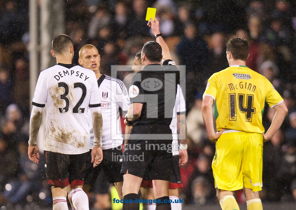 Picture by Alan Stanford/Focus Images Ltd +44 7915 056117<br /> 04/02/2014<br /> Steve Sidwell of Fulham is shown the yellow card by referee Neil Swarbrick during the The FA Cup match at Craven Cottage, London