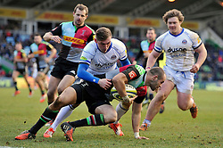 Ross Chisholm of Harlequins is tackled by Richard Lane of Bath Rugby - Photo mandatory by-line: Patrick Khachfe/JMP - Mobile: 07966 386802 31/01/2015 - SPORT - RUGBY UNION - London - The Twickenham Stoop - Harlequins v Bath Rugby - LV= Cup
