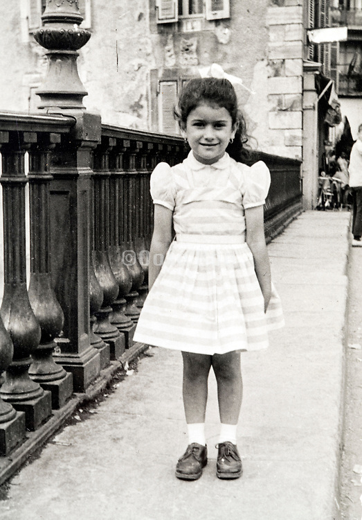little girl posing France ca 1960s