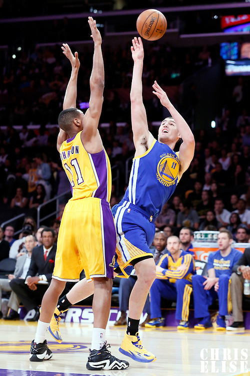 11 April 2014: Golden State Warriors guard Klay Thompson (11) takes a jumpshot over Los Angeles Lakers forward Wesley Johnson (11) during the Golden State Warriors 112-95 victory over the Los Angeles Lakers at the Staples Center, Los Angeles, California, USA.