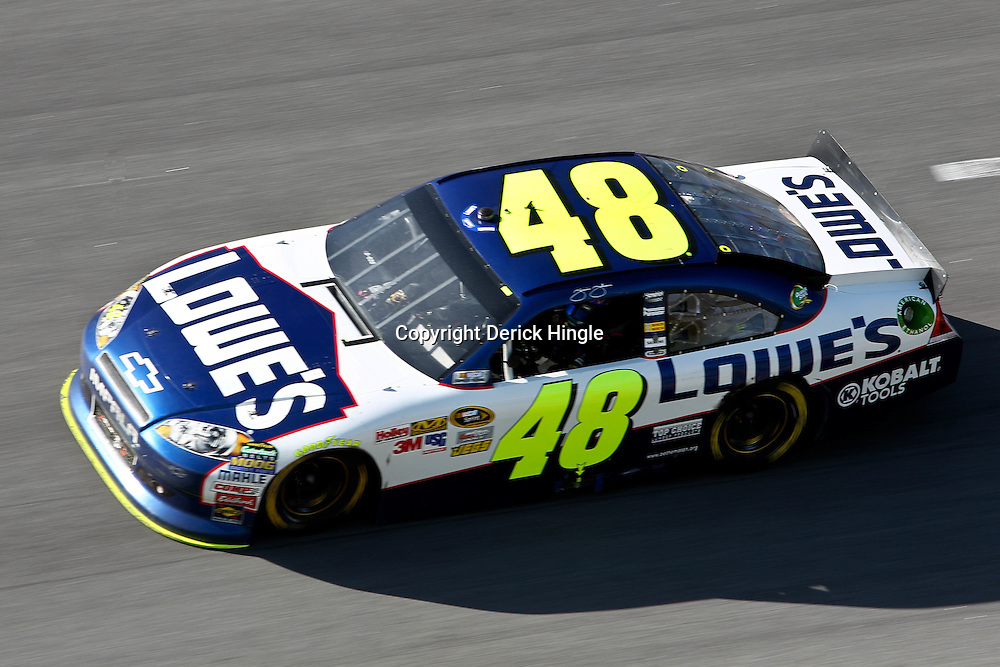 April 17, 2011; Talladega, AL, USA; NASCAR Sprint Cup Series driver Jimmie Johnson (48) looks out as he takes a victory lap following the Aarons 499 at Talladega Superspeedway.   Mandatory Credit: Derick E. Hingle