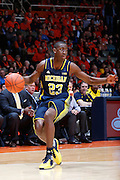 CHAMPAIGN, IL - MARCH 4: Caris LeVert #23 of the Michigan Wolverines handles the ball during the game against the Illinois Fighting Illini at State Farm Center on March 4, 2014 in Champaign, Illinois. Michigan defeated Illinois 84-53. (Photo by Joe Robbins)