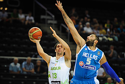 Domen Lorbek of Slovenia vs  Ioannis Bourousis  of Greece during friendly match between National Teams of Slovenia and Greece before World Championship Spain 2014 on August 17, 2014 in Kaunas, Lithuania. Photo by Robertas Dackus / Sportida.com