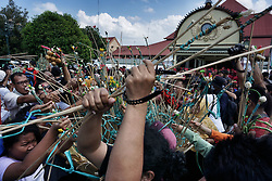 June 26, 2017 - Yogyakarta, Indonesia - Javanese people arrange the 'Gunungan' during Grebeg Syawal ceremony in front of the Grand Mosque Kauman in Yogyakarta, Indonesia on June 26, 2017. This tradition is a symbol of alms from the Sultan of Yogyakarta to his people to celebrate Eid Al-Fitr. (Credit Image: © Nugroho Hadi Santoso/NurPhoto via ZUMA Press)