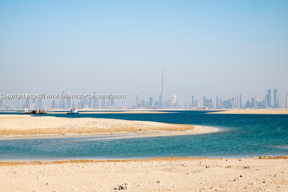 Skyline of Dubai from The World manmade reclaimed islands off Dubai coast in  United Arab Emirates