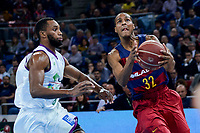 Unicaja's Kyle Fogg and FCB Lassa's Xavier Mumford during Quarter Finals match of 2017 King's Cup at Fernando Buesa Arena in Vitoria, Spain. February 17, 2017. (ALTERPHOTOS/BorjaB.Hojas)