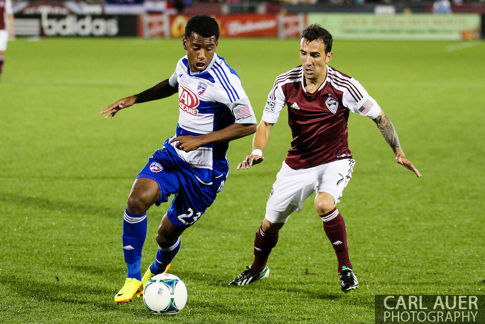 September 14th, 2013 -  FC Dallas midfielder Kellyn Acosta (23) keeps the ball away from Colorado Rapids forward Vicente Sánchez (7) in first half action of the MLS Soccer game between FC Dallas and the Colorado Rapids at Dick's Sporting Goods Park in Commerce City, CO