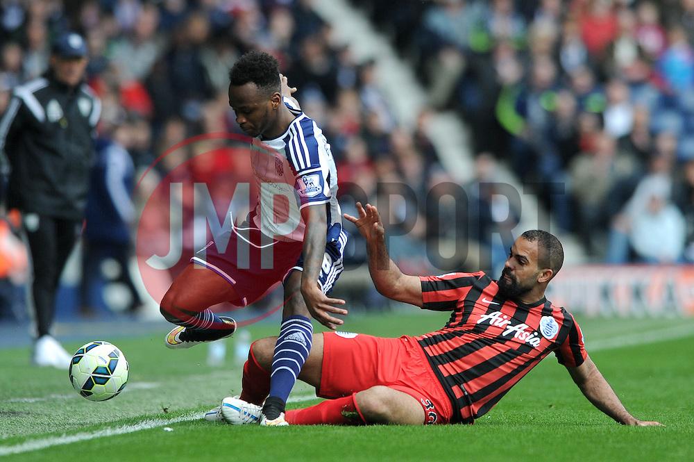 West Bromwich Albion's Saido Berahino is tackled by Queens Park Rangers' Sandro - Photo mandatory by-line: Dougie Allward/JMP - Mobile: 07966 386802 - 04/04/2015 - SPORT - Football - West Bromwich - The Hawthorns - West Bromwich Albion v QPR - Barclays Premier League