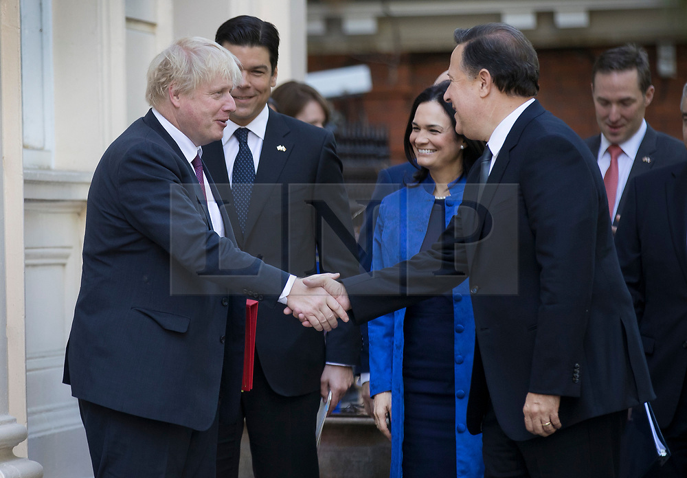 © Licensed to London News Pictures. 14/05/2018. London, UK.  British Foreign Secretary Boris Johnson shakes hands with President Juan Carlos Varela of Panama, as Vice President Isabel Saint Malo looks on during their visit to London. Photo credit: Peter Macdiarmid/LNP
