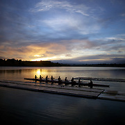 Rowers training at dawn on Lake Karapiro, near Cambridge, Waikato. Many national and international rowing competitions are held on Lake Karapiro which is also the home of The Rowing New Zealand High Performance Centre. Lake Karapiro hosted the 2010 World Rowing Championships. Lake Karapiro, Waikato,  New Zealand. 15th December 2010. Photo Tim Clayton