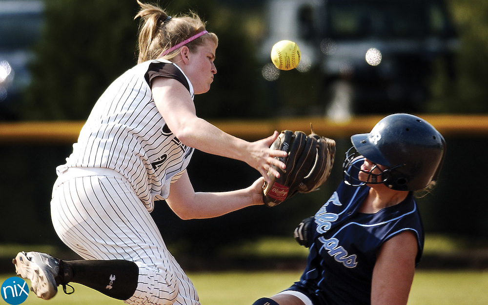 Central Cabarrus' Pam Wade loses control of the ball while trying to tag out West Rowan baserunner #11 out at second base Wednesday afternoon.