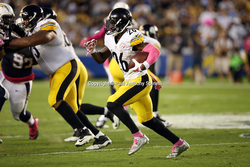 Pittsburgh Steelers running back Le'Veon Bell (26) runs for a gain of 25 yards to the San Diego Chargers 28 yard line in the second quarter during the 2015 NFL week 5 regular season football game against the San Diego Chargers on Monday, Oct. 12, 2015 in San Diego. The Steelers won the game 24-20. (©Paul Anthony Spinelli)