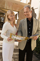 Couple Looking at Real Estate Brochure