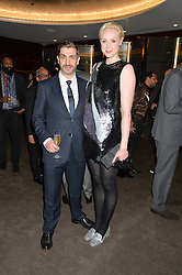 GWENDOLINE CHRISTIE and DAVID WADDINGTON at a dinner hosted by Liberatum to honour Francis Ford Coppola held at the Bulgari Hotel & Residences, 171 Knightsbridge, London on 17th November 2014.