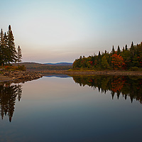 I traveled way up north to New Hampshire to Colebrook and North Country near the Canadian border and stopped at Second Connecticut Lake for a sunset photo. The entire scenery was so serene and inspired this image<br />
