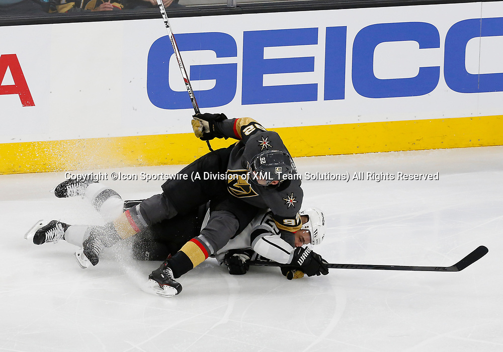 LAS VEGAS, NV - APRIL 11: Los Angeles Kings right wing Dustin Brown (23) collides with Vegas Golden Knights left wing Tomas Nosek (92) during Game One of the Western Conference First Round of the 2018 NHL Stanley Cup Playoffs between the L.A. Kings and the Vegas Golden Knights Wednesday, April 11, 2018, at T-Mobile Arena in Las Vegas, Nevada. The Golden Knights won 1-0.  (Photo by: Marc Sanchez/Icon Sportswire)