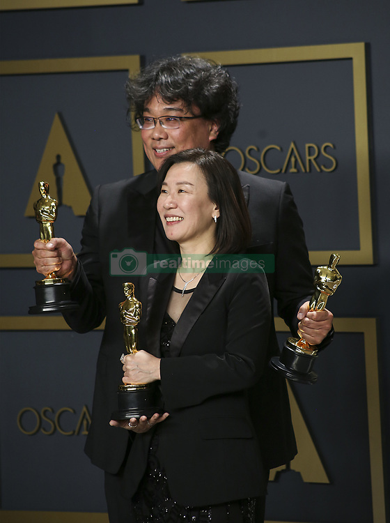 """February 9, 2020, Hollywood, California, USA: Director Bong Joon-ho and producer Kwak Sin-ae, winners of the Original Screenplay, International Feature Film, Directing, and Best Picture awards for """"Parasite,"""" pose in the press room of the 92nd Academy Awards on Sunday February 9, 2020 at the Dolby Theater in Hollywood, California. BURT HARRIS/BNS/PI (Credit Image: © Prensa Internacional via ZUMA Wire)"""