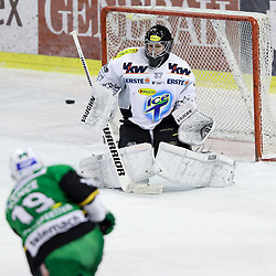 16.12.2012, Hala Tivoli, Ljubljana, SLO, EBEL, HDD Telemach Olimpija Ljubljana vs Dornbirner Eishockey Club, 31. Runde, in picture Ziga Pance (HDD Telemach Olimpija, #19) scores a goal vs Patrick Desrochers (Dornbirner Eishockey Club, #37) during the Erste Bank Icehockey League 31st Round match between HDD Telemach Olimpija Ljubljana and Dornbirner Eishockey Club at the Hala Tivoli, Ljubljana, Slovenia on 2012/12/16. (Photo By Matic Klansek Velej / Sportida)
