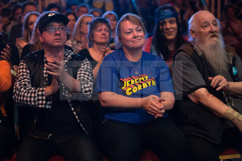 © Licensed to London News Pictures. 07/07/2016. LONDON, UK.  Momentum supporters including one supporter wearing a blue Jeremy Corbyn tee shirt at a rally in support of keeping Jeremy Corbyn as the Labour party leader at the Troxy in east London on 6th July 2016. The event was organised by Momentum, a group of Labour Party supporters who are campaigning for Jeremy Corbyn to remain as leader of the Labour Party, following the recent resignation of many shadow cabinet MP's and the growing likelihood of a Labour Party leadership challenge..  Photo credit: Vickie Flores/LNP