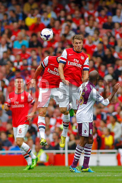 Arsenal's Jack Wilshere jump for the ball  - Photo mandatory by-line: Mitch Gunn/JMP - Tel: Mobile: 07966 386802 17/08/2013 - SPORT - FOOTBALL - Emirates Stadium - London -  Arsenal V Aston Villa - Barclays Premier League