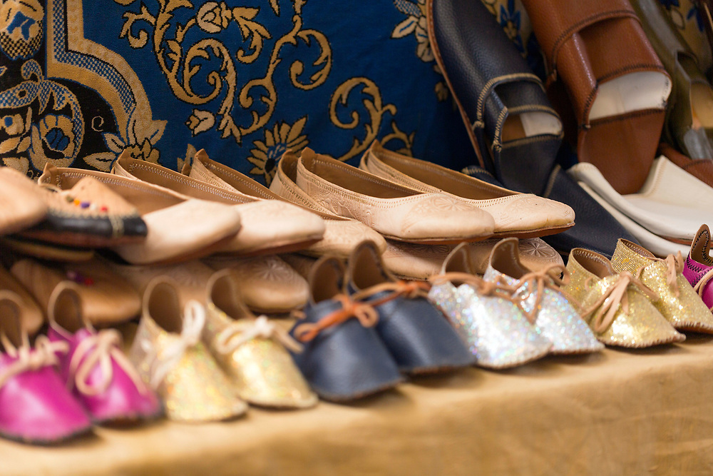 FEZ, MOROCCO - 3rd DECEMBER 2016 - Leather babouche slippers and shoes for sale in the souks of the old Fez Medina, Middle Atlas Mountains, Morocco.
