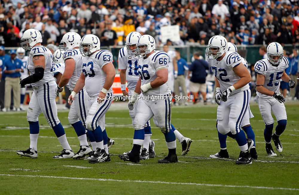 The Indianapolis Colts offense breaks the huddle and walks to the line of scrimmage during the NFL week 16 football game against the Oakland Raiders on Sunday, December 26, 2010 in Oakland, California. The Colts won the game 31-26. (©Paul Anthony Spinelli)