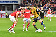 Bristol City striker Lee Tomlin (10) under attack from Barnsley FC midfielder Sam Morsy (29) and Barnsley FC defender James Bree (2) during the EFL Sky Bet Championship match between Barnsley and Bristol City at Oakwell, Barnsley, England on 29 October 2016. Photo by Ian Lyall.