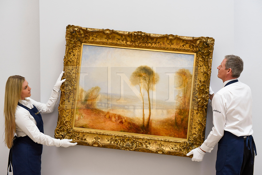 """© Licensed to London News Pictures. 28/06/2019. LONDON, UK. Technicians hang """"Landscape with Walton Bridges"""" by J.M.W. Turner (Est. GBP4-6m) at the preview of Sotheby's Old Masters sale which takes place at its New Bond Street galleries on 3 July.  Photo credit: Stephen Chung/LNP"""