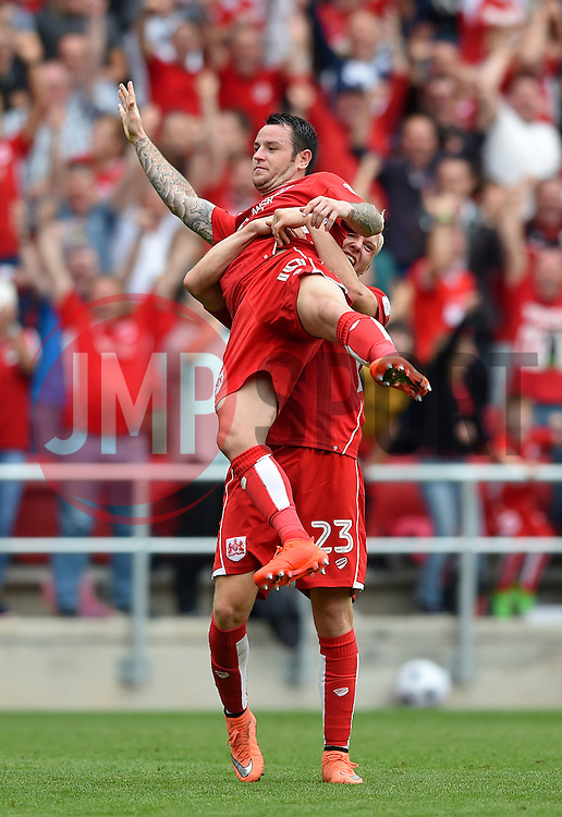 Lee Tomlin of Bristol City is lifted aloft by Hordur Magnusson of Bristol City as (Tomlin) celebrates his goal  - Mandatory by-line: Joe Meredith/JMP - 27/08/2016 - FOOTBALL - Ashton Gate - Bristol, England - Bristol City v Aston Villa - Sky Bet Championship