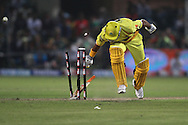 Suresh Raina of the Chennai Super Kings collides with the stumps as he makes his ground during match 13 of the Airtel CLT20 between The Superkings and the Victorian Bushrangers held at St Georges Park in Port Elizabeth on the 18 September 2010..Photo by: Shaun Roy/SPORTZPICS/CLT20