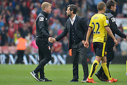 Bournemouth Manager Eddie Howe and Watford FC manager Enrique Sanchez  at end of the Barclays Premier League match between Bournemouth and Watford at the Goldsands Stadium, Bournemouth, England on 3 October 2015. Photo by Mark Davies.