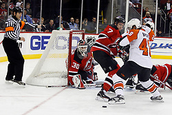 November 8, 2007; Newark, NJ, USA;   New Jersey Devils goalie Martin Brodeur (30) watches as New Jersey Devils defenseman Paul Martin (7) and Philadelphia Flyers center Daniel Briere (48) fight for the loose puck during the third period at the Prudential Center in Newark, NJ.