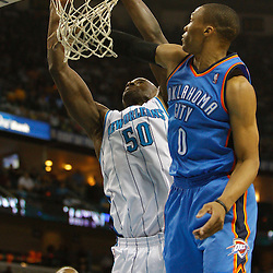 January 24,  2011; New Orleans, LA, USA; New Orleans Hornets center Emeka Okafor (50) dunks over Oklahoma City Thunder point guard Russell Westbrook (0) during the second quarter at the New Orleans Arena. Mandatory Credit: Derick E. Hingle