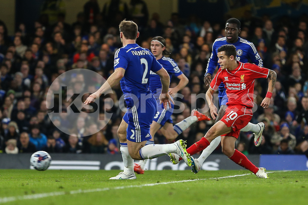 Philippe Coutinho of Liverpool (10) shoots during the Capital One Cup Semi Final 2nd Leg match between Chelsea and Liverpool at Stamford Bridge, London, England on 27 January 2015. Photo by David Horn.