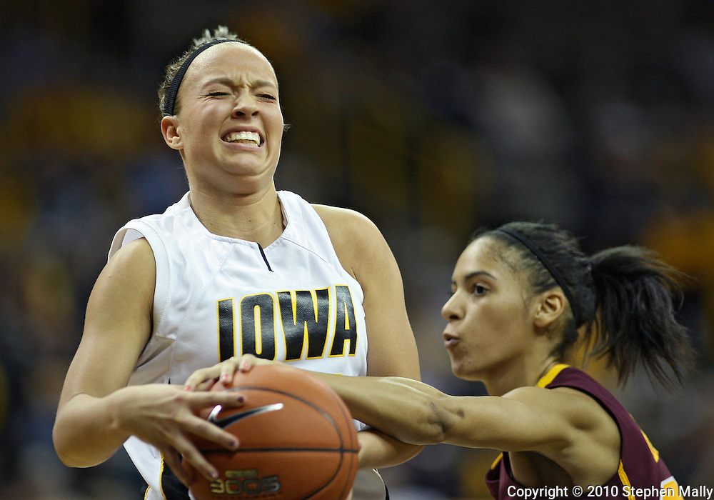 February 18, 2010: Iowa center Trisha Nesbitt (11) is fouled by Minnesota guard Kiara Buford (30) as she drives to the basket during the second half of the NCAA women's basketball game at Carver-Hawkeye Arena in Iowa City, Iowa on February 18, 2010. Iowa defeated Minnesota 75-54.