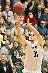 14 March 2014:  Andrew Ziemnik during an NCAA mens division 3 quarter final basketball game between the Calvin Knights and the Illinois Wesleyan Titans in Shirk Center, Bloomington IL