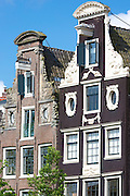 Traditional decorative Dutch gabled buildings - Dutch gables - on Prinsengracht in Amsterdam, Holland, The Netherlands