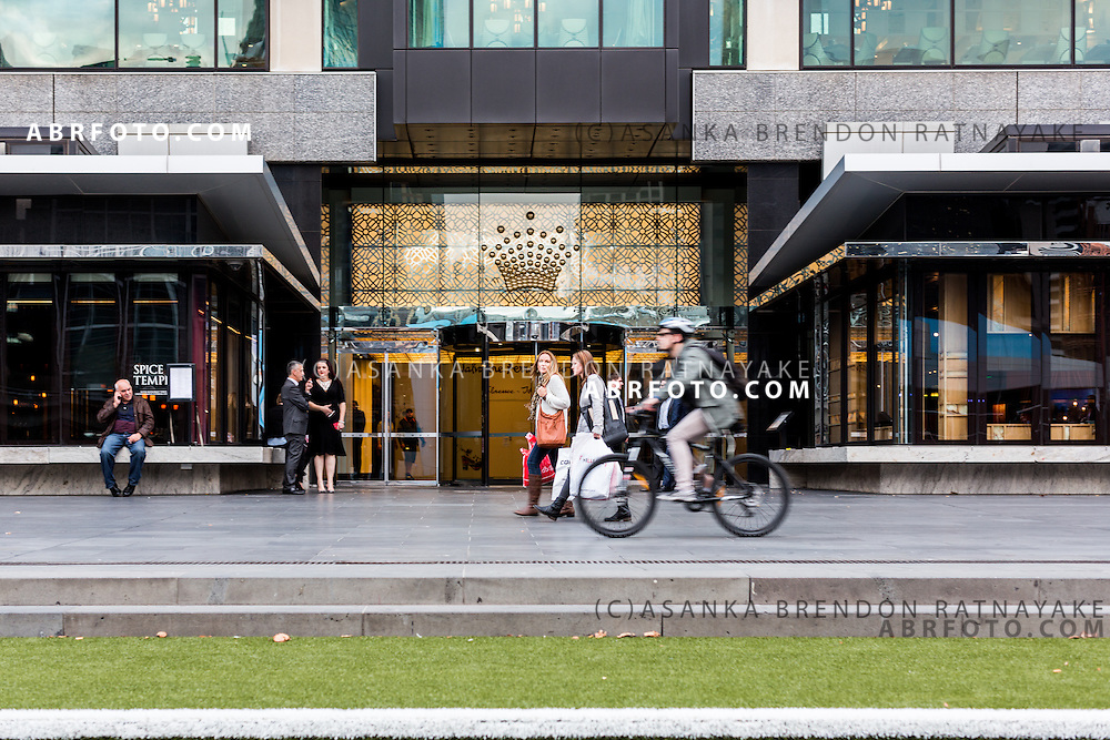 People outside of one of the entrances of Crown Casino Melbourne Victoria Australia