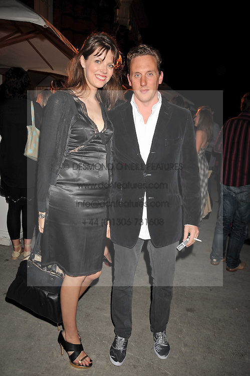 HARRY BECHER and GENEVIEVE CHAPMAN at the Quintessentially and Perrier-Jouet Belle Epoque Summer Party in association with Jaguar held at The Orangery, Kensington Palace, London on 18th June 2009.