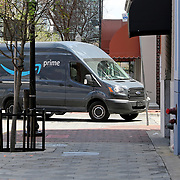 An Amazon delivery truck drives down Orange Avenue as it delivers packages in downtown Orlando on Monday, March 30, 2020 in Orlando, Florida. (Alex Menendez via AP)