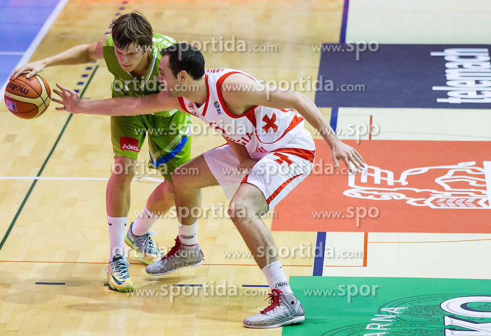 Jaka Klobucar of Slovenia vs Duda Sanadze of Georgia during friendly basketball match between National teams of Slovenia and Georgia in day 2 of Adecco Cup 2014, on July 25, 2014 in Dvorana OS 1, Murska Sobota, Slovenia. Photo by Vid Ponikvar / Sportida.com