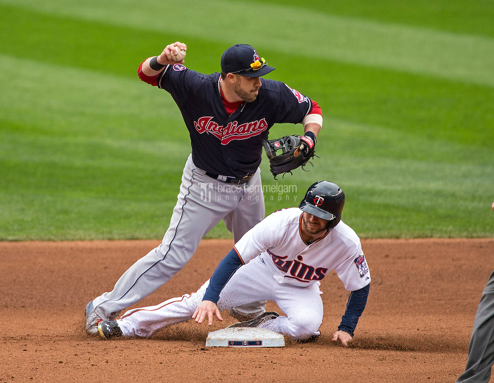 MINNEAPOLIS, MN- APRIL 19: Jason Kipnis #22 of the Cleveland Indians throws as Shane Robinson #21 of the Minnesota Twins slides on April 19, 2015 at Target Field in Minneapolis, Minnesota. The Twins defeated the Indians 7-2. (Photo by Brace Hemmelgarn) *** Local Caption *** Jason Kipnis;Shane Robinson