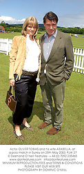 Actor OLIVER TOBIAS and his wife ARABELLA, at a polo match in Surrey on 25th May 2003.PJW 27