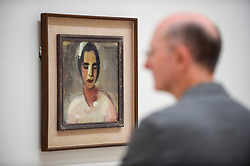 "© Licensed to London News Pictures. 17/07/2019. LONDON, UK. A visitor views ""Girl from California I"", 1919, by Helene Schjerfbeck at the preview of the first solo UK exhibition of Finnish artist Helene Schjerfbeck at the Royal Academy of Arts in Piccadilly.  The exhibition features around 65 portraits, landscapes and still lifes and runs 20 July to 27 October 2019.  Photo credit: Stephen Chung/LNP"